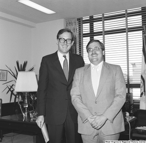 "[""Senator John D. (Jay) Rockefeller stands for a photograph with an unidentified man in his office.""]%"