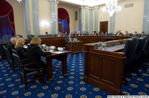 "[""This image is of the committee room of a Commerce Committee hearing.""]%"