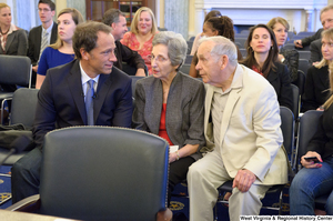 "[""Mike Rowe, a television personality, sits beside his parents at Senate Commerce Committee hearing.""]%"