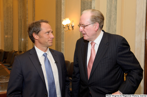 "[""Senator John D. (Jay) Rockefeller and Mike Rowe chat after a Senate Commerce Committee hearing.""]%"