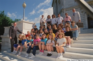 "[""Senator John D. (Jay) Rockefeller stands with a group of West Virginia students on the steps of the Senate.""]%"
