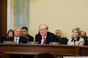 "[""Senators John D. (Jay) Rockefeller, Kay Hutchison, and Bill Nelson listen to testimony at a Commerce Committee hearing.""]%"