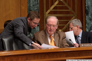 "[""Senator John D. (Jay) Rockefeller receives a sheet of paper from an aide during a Finance Committee hearing.""]%"