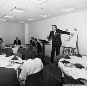"[""Senator John D. (Jay) Rockefeller points to a map of the Appalachian Region as he speaks at an event.""]%"