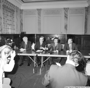 "[""Senator John D. (Jay) Rockefeller and four other men sit behind a table at some sort of press event at the Senate.""]%"