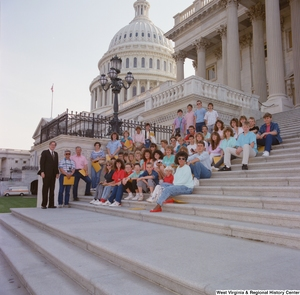 "[""Senator John D. (Jay) Rockefeller stands next to a school group on the steps of the Senate.""]%"