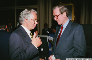 "[""At the Celebrating Telemedicine event about healthcare technology, Senator John D. (Jay) Rockefeller speaks to one of the attendees.""]%"