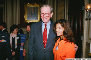 "[""Senator John D. (Jay) Rockefeller poses for a photograph with a woman at the Celebrating Telemedicine conference.""]%"