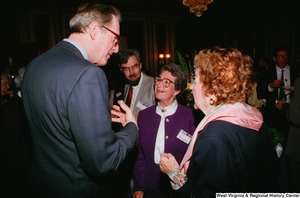 "[""Senator John D. (Jay) Rockefeller talks with people at the Celebrating Telemedicine event in the Senate.""]%"