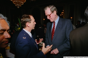 "[""Senator John D. (Jay) Rockefeller speaks with a military member at a Celebrating Telemedicine conference.""]%"