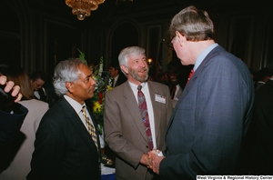 "[""Senator John D. (Jay) Rockefeller and a doctor shake hands at a Celebrating Telemedicine conference.""]%"