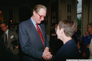 "[""Senator John D. (Jay) Rockefeller shakes hands with an unidentified woman at a Celebrating Telemedicine conference.""]%"