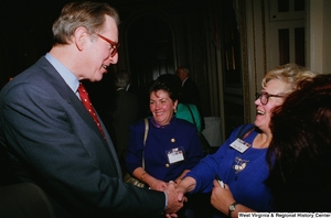 "[""Senator John D. (Jay) Rockefeller shakes hands with a healthcare professional during the Celebrating Telemedicine conference in Washington.""]%"
