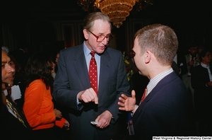 "[""Senator John D. (Jay) Rockefeller speaks with an unidentified man at the Celebrating Telemedicine conference.""]%"