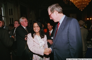 "[""Senator John D. (Jay) Rockefeller shakes hands with a woman at the Celebrating Telemedicine conference in Washington.""]%"