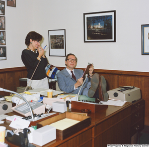 "[""Senator John D. (Jay) Rockefeller props his legs up on a desk and speaks to an unidentified staff member in his Washington office.""]%"