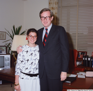 "[""This color photograph shows Senator John D. (Jay) Rockefeller embracing an unidentified individual in his office.""]%"