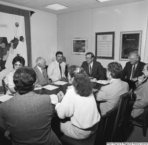 "[""Senator John D. (Jay) Rockefeller sits around a conference table in his office at a planning meeting for the Blackwater Canyon Railroad project.""]%"