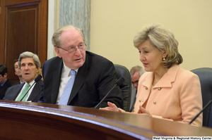 "[""Senators John D. (Jay) Rockefeller and Kay Hutchison speak during a Commerce Committee hearing.""]%"