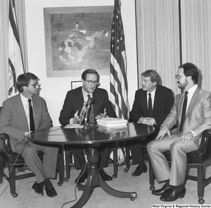 "[""Senator John D. (Jay) Rockefeller sits at a round table in his office with three representatives from the steel industry.""]%"