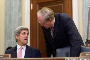 "[""Senator John D. (Jay) Rockefeller speaks with Senator Kerry before a Commerce Committee hearing.""]%"