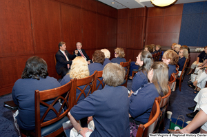 "[""Senators John D. (Jay) Rockefeller and Joe Manchin speak to a room of women.""]%"