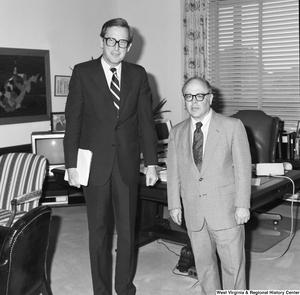 "[""Senator John D. (Jay) Rockefeller stands with an engineering professor from West Virginia University in his Washington office.""]%"
