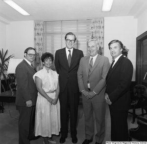 "[""Senator John D. (Jay) Rockefeller stands in his office for a photograph with four representatives from the West Virginia Education Fund.""]%"