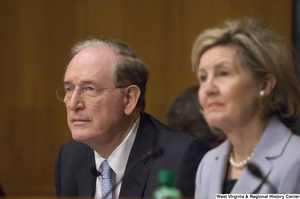 "[""Senator John D. (Jay) Rockefeller and Senator Kay Hutchison listen to testimony at a Commerce Committee hearing.""]%"