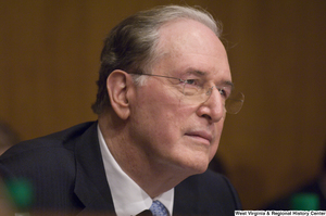 "[""Senator John D. (Jay) Rockefeller listens intently to testimony at a Commerce Committee hearing.""]%"