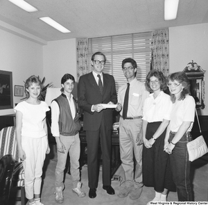 "[""Senator John D. (Jay) Rockefeller stands for a photograph with a group of students from the Mountain State Academy in West Virginia.""]%"