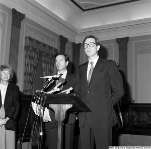 "[""Senator John D. (Jay) Rockefeller stands behind a podium with Senator John Heinz at his side.""]%"