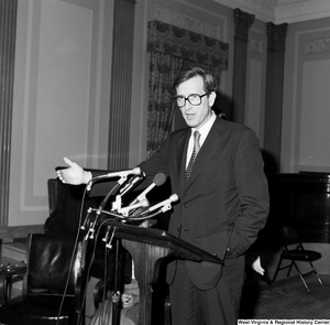 "[""Senator John D. (Jay) Rockefeller speaks with an arm outstretched at one of the Senate buildings.""]%"