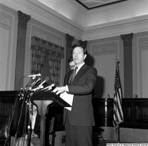"[""Senator John Heinz speaks from behind a podium. Senator John D. (Jay) Rockefeller stands behind him and looks at the floor.""]%"