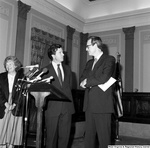 "[""Senator John D. (Jay) Rockefeller and Senator John Heinz smile at one another after they have spoken to an audience about the Dislocated Workers Improvement Act of 1987.""]%"