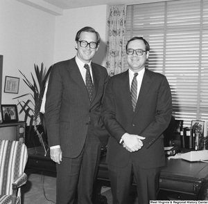 "[""Senator John D. (Jay) Rockefeller stands in his office for a photograph with an unidentified man.""]%"
