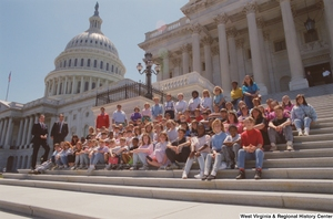 "[""Senator John D. (Jay) Rockefeller stands beside a group of West Virginia students on the steps of the Senate.""]%"