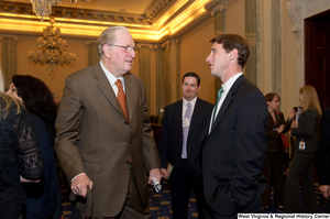 "[""Senator John D. (Jay) Rockefeller talks with a young man at an event in the Senate.""]%"