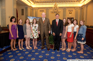"[""Senators John D. (Jay) Rockefeller and Joe Manchin stand with a group of girls in the Senate.""]%"