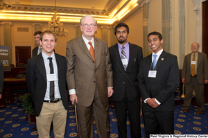 "[""Senator John D. (Jay) Rockefeller stands next to three young men at a West Virginia Wednesday event.""]%"