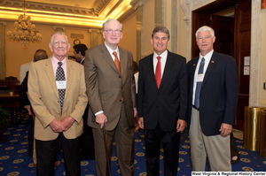 "[""Senators John D. (Jay) Rockefeller and Joe Manchin stand with two men at a West Virginia Wednesday event in the Senate.""]%"