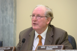 "[""Senator John D. (Jay) Rockefeller chairs a Commerce Committee hearing in June 2012.""]%"