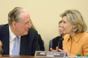 "[""Senators John D. (Jay) Rockefeller and Kay Hutchison chat during a Commerce Committee hearing.""]%"