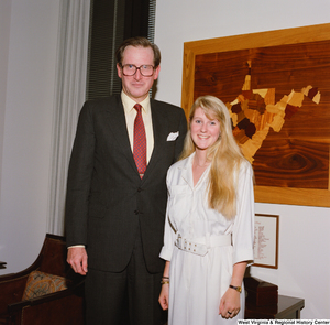 "[""Senator John D. (Jay) Rockefeller stands next to an intern in his office.""]%"