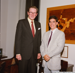 "[""An intern stands beside Senator John D. (Jay) Rockefeller in his office.""]%"