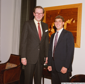 "[""An intern stands next to Senator John D. (Jay) Rockefeller in his office.""]%"