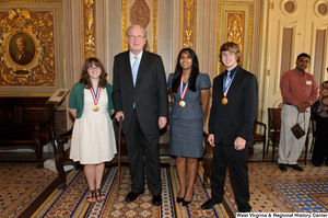 "[""Senator John D. (Jay) Rockefeller stands with three West Virginia high school graduates who won the Presidential Scholars award.""]%"