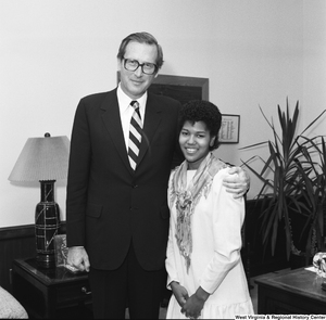 "[""An unknown individual stands for a photograph with Senator John D. (Jay) Rockefeller in his Washington office.""]%"