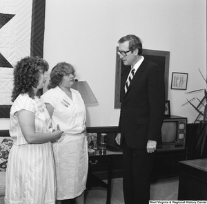 "[""Senator John D. (Jay) Rockefeller speaks with two unidentified individuals in his office.""]%"