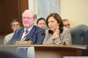 "[""Senators John D. (Jay) Rockefeller and Maria Cantwell sit beside one another at a Commerce Committee hearing.""]%"